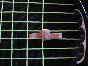 Vibration dampener for tennis racquet
